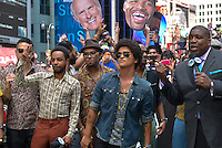 Bruno Mars (in jean jacket and sunglasses) confirmed that he will play during the Pepsi Super Bowl XLVIII Halftime Show at MetLife Stadium in East Rutherford, NJ on Sunday, February 2, 2014. He did this in New York City on the Fox NFL Sunday Program. / Russ DeSantis / AP Images for National Football League