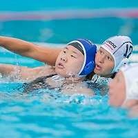 He Jin (L) of China and Kata Menczinger (beck R) of Hungary fight during the women waterpolo friendly match of Hungary and China in Tatabanya, Hungary on June 23, 2012. ATTILA VOLGYI