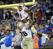 Florida State running back Dalvin Cook (4) is congratulated by offensive lineman Wilson Bell (78) after rushing for a 29-yard touchdown during the second half of an NCAA college football game against Florida in Gainesville, Fla., Saturday, Nov. 28, 2015. Florida State won 27-2. (AP Photo/Phelan M. Ebenhack)