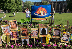 © Licensed to London News Pictures.  14/06/2018; Bristol, UK. Vigil on Bristol's College Green for the one year anniversary of the Grenfell Tower fire in London, which caused 72 deaths and many injuries. The vigil was hosted by Avon Fire Brigades Union (FBU) with the FBU's South West Regional Official Tam McFarlane. Photo credit: Simon Chapman/LNP