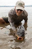 Angler Drew Price displays a 30+ pound fly caught carp on Lake Champlain, Vermont