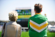 27 March 2010 : James Slater (right) watches a relay of the timber race on the television monitor.
