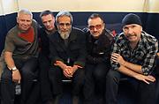 Larry Mullen, Yusuf Islam (Cat Stevens), Bono and The Edge (U2) backstage Island 50 concerts Hammersmith Empire - London 2009