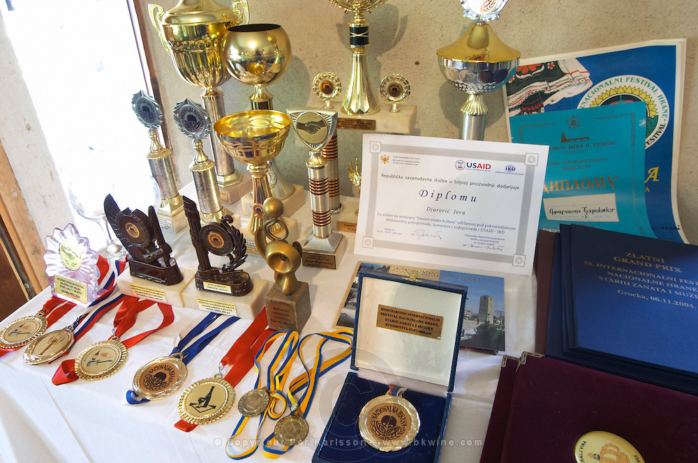Medals displayed in the winery that Durovic Jovo has won in wine competitions. Durovic Jovo Winery, Dupilo village, wine region south of Podgorica. Vukovici Durovic Jovo Winery near Dupilo. Montenegro, Balkan, Europe.
