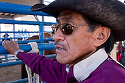 10 SEPTEMBER 2004 - WINDOW ROCK, AZ:  Sammy Slivers Jr., a 54 year old bull rider, gets his rigging ready before his ride at the seniors rodeo  during the 58th annual Navajo Nation Fair in Window Rock, AZ. Slivers said he has been rodeoing since 1963 and was the 2002 bullriding champion for cowboys more than 50 years old on the Navajo reservation. The Navajo Nation Fair is the largest annual event in Window Rock, the capitol of the Navajo Nation, the largest Indian reservation in the US. The Navajo Nation Fair is one of the largest Native American events in the United States and features traditional Navajo events, like fry bread making contests, pow-wows and an all Indian rodeo.  PHOTO BY JACK KURTZ