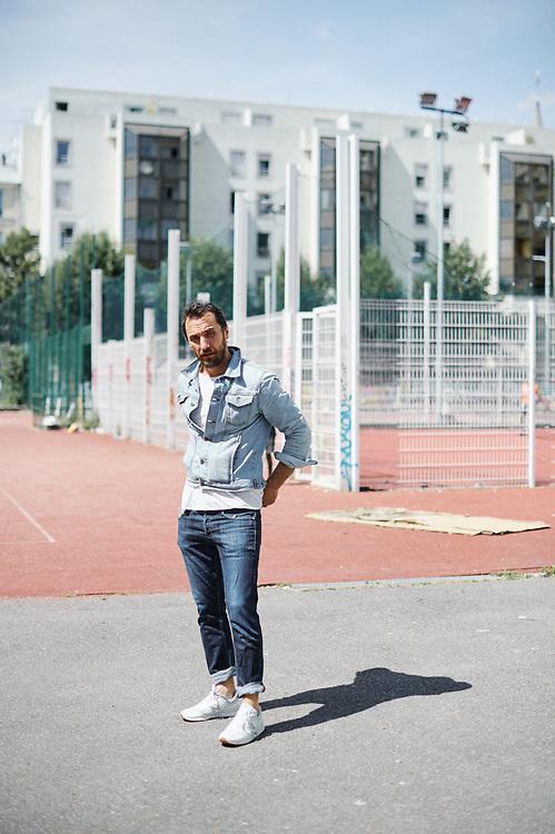 Actor Firat Celik posing in the street. Paris, France. July 8, 2019.<br /> Le comedian Firat Celik, prenant la pose dans la rue. Paris, France. 8 juillet 3019.