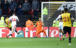 Watford's Andre Gray (left) scores his side's second goal of the game