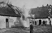 World War I 1914-1918: Fighting a fire on a farm in Artois, France, set alight by German shellfire.  Being on the front line between German and Allied forces the area suffered severe damage.  From  'Le Flambeau', Paris, 18 September 1915.