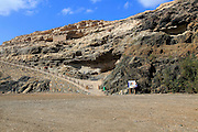 Start of cliff top coastal path on beach at the coastal village of Ajuy, Fuerteventura, Canary Islands, Spain