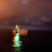 """A Customs and Border Protection boat patrols the Pacific Ocean before dawn near the US/Mexico border for undocumented immigrants as well as gun smugglers attempting to bring guns into Mexico. For more images, search for """"immigration by air and sea"""". Please contact Todd Bigelow directly with your licensing requests."""