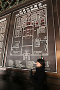 China, Beijing, A Chinese guide is standing by a map of The Imperial Palace in the Forbidden City