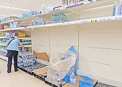 © Licensed to London News Pictures 22/07/2021. Gillingham, UK. Empty shelves in the water aisle at Gillingham Tesco in Kent. Shoppers are seeing a shortage of bottled water in supermarkets today as supplies have been hit by staff being forced to self-isolate. Photo credit:LNP