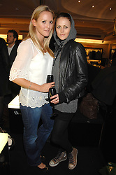 Left to right, actress CLEMENCY BURTON-HILL and AMBER SAINSBURY at a party to celebrate the 5th anniversary of Grand Classics held at the Dom Perignon OEnotheque Bar at Harrods, Knightsbridge, London on 14th February 2008.<br />