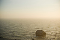 Lone rock in Pacific ocean at sunset, Humboldt country, California