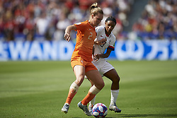July 7, 2019 - Lyon, France - Desiree Van Lunteren (Sc Freiburg) of Netherlands and Crystal Dunn (NC Courage) of United States competes for the ball during the 2019 FIFA Women's World Cup France Final match between The United State of America and The Netherlands at Stade de Lyon on July 7, 2019 in Lyon, France. (Credit Image: © Jose Breton/NurPhoto via ZUMA Press)