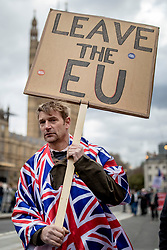 "© Licensed to London News Pictures. 13/03/2019. London, UK. A pro-Brexit protester wearing a Union Jack cape marches through Westminster as MPs continue to debate a series of key votes on Brexit. MPs will vote on whether to remove the option of a ""no deal"" departure from the EU today, after Prine Minister Theresa May's proposed deal was defeated for a second time last night. Photo credit: Rob Pinney/LNP"