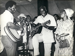 Feb. 05, 1975 - February 4th, 1975 Guiatar playing president – Dr. Kenneth Kaunda, President of Zambia, recently paid an official visit to Sri Lanka, accompanied by his wife. Photo Shows: Mrs. Kaunda sings a Zambian song as President Kaunda (centre) accompanies her on the guitar and informal picture taken when they visited a seaside hotel at Bentota, in Sri Lanka. (Credit Image: © Keystone Press Agency/Keystone USA via ZUMAPRESS.com)