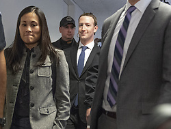 Surrounded by staff and security, Mark Zuckerberg, Co-Founder and Chief Executive Officer of Facebook, walks to United States Senator Dianne Feinstein's (Democrat of California) office as he makes the rounds on Capitol Hill prior to giving testimony before Congress on Tuesday and Wednesday on Monday, April 9, 2018 in Washington, DC, USA. Photo by Ron Sachs/CNP/ABACAPRESS.COM