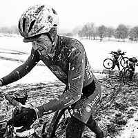 A rider focuses on getting up a snowy hill during the Illinois State Cyclocross Championships.