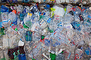 Stacks of Polyethylene terephthalate (PET or PETE) bottles, recycliing symbol #1. Recycling Center, Los Angeles, California, USA