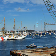 The U.S. Coast Guard Eagle sails into Portsmouth Harbor on August 2, 2013, to participate in Sail Portsmouth, hosted by the Piscataqua Maritime Commission. The new Memorial Bridge and Portsmouth Naval Shipyard are in the background.