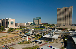 Light rail train and buses at the Houston Metro transit hub in the Texas Medical Center.