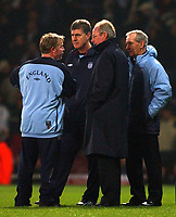 Photo. Javier Garcia<br />12/02/2003 England v Australia, Friendly International, Upton Park<br />England management, l-r Sammy Lee, Brian Kidd, Sven Goran Eriksson and Tord Grip discuss what to do after learning of the delayed kick off