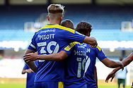 AFC Wimbledon striker Joe Pigott (39) celebrates with AFC Wimbledon attacker Shane McLoughlin (19) GOAL 3-2 during the EFL Sky Bet League 1 match between AFC Wimbledon and Plymouth Argyle at the Kiyan Prince Foundation Stadium, London, England on 19 September 2020.