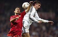 4/2/2004 Madrid, Spain.<br />Copa Del Rey (Spanish Cup) Semifinals. 1 Leg.<br />R.Madrid 2 - Sevilla 0<br />R.Madrid's Javier Portillo in duel with Sevilla's David at Santiago Bernabeu's Stadium.