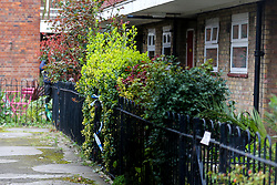© Licensed to London News Pictures. 26/03/2021. London, UK. Police tape on the fence outside a residential property on Kent Street in Newham, East London following death of an elderly woman. Police were called just after 10pm on Thursday, 25 March and found the 76-year-old woman dead. A man aged in his 30s was arrested at the scene on suspicion of murder and remains in police custody. Photo credit: Dinendra Haria/LNP
