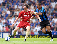 Photo: Daniel Hambury.<br /> Portsmouth v Inter Milan. Pre Season Friendly.<br /> 31/07/2005.<br /> Portsmouth's Andy O'Brien and Inter's Adriano battle for the ball.