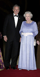 Britain's Queen Elizabeth II is greeted by American President George W Bush  at Winfield House, home of The American Ambassador in London. President Bush is hosting a reciprocal banquet. *  The Presidential party travel to the north of England tomorrow to visit Prime Minister Tony Blair's Sedgefield constituency.