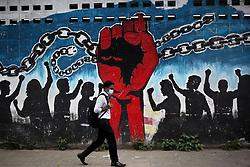 April 18, 2020, Dhaka, Bangladesh: A man walks past street graffiti during a government imposed lockdown amid corona virus epidemic in Dhaka, Bangladesh. (Credit Image: © Syed Mahamudur Rahman/NurPhoto via ZUMA Press)