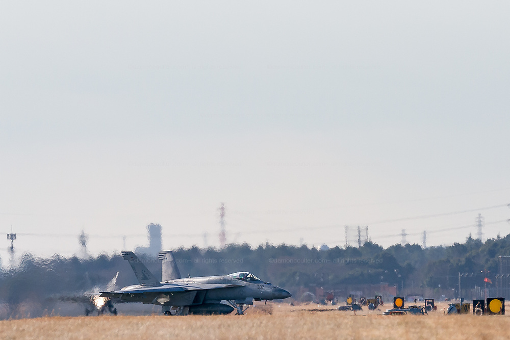 Two F/A18E, Super Hornets of the Strike Fighter Squadron 115 (VFA 115) of the US Navy Carrier Air Wing 5 taxi to a refuelling stop after landing at Naval Air Facility, Atsugi, Yamato, Kanagawa, Japan. Wednesday January 16th 2019