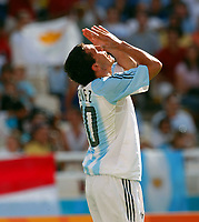 28/08/04 - ATHENS - GREECE -  - OLYMPIC FOOTBALL - FINAL MATCH - MENS  -  At the Olympic Stadium in Athens<br />ARGETNINA (1) win over PARAGUAY (0).<br />Argentine player N* 10 CARLOS TEVEZ PRAY (REZANDO) after make his goal.<br />© Gabriel Piko / Argenpress.com / Piko-Press