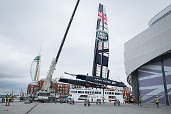 © Licensed to London News Pictures. 15/07/2016. Portsmouth, United Kingdom.  Team Land Rover BAR (Ben Ainslie Racing) preparing the boat for training this morning at the BAR Headquarters on the Camber in Portsmouth. The team are currently preparing for the America's Cup World Series (ACWS) event being held in Portsmouth between 22-24th July 2016. Photo credit: Rob Arnold/LNP