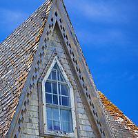 North America, Canda, Nova Scotia, Guysborough County. Architectural character of yellow weathered home of Nova Scotia.