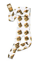 """July 25, 2017 - inconnu - Fast food chain McDonald's has unveiling a tasty line of line of apparel and goods.The McDelivery Collection was commissioned in celebration of Global Delivery Day on July 26 when the company launches a home delivery is selected countries and cities.The collection is available via the UberEATS app in select countries. It is UberEATS which will be delivering the food.Launch countries include the USA, United Kingdom, France, Australia, Poland, Canada, the Netherlands, New Zealand and Hong Kong.It's a limited-edition set which includes a World Famous Fries jogging suit, a Big Mac onesies and slippers that read """"World Famous.""""There's even a contraption for filling with chicken dipper sauce for dunking the mini bites into.There's also a pillow which is printed with a giant burger motif and a picnic blanket.The launch offer gives McDoanlds fans a chance to obtain one free collection item when using the delivery option booked only through the UberEATS app. A McDonald's spokeswoman said: """"At McDonald's, we continue to raise the bar for our customers—with new recipes, a fresher look, and now new levels of convenience through McDelivery with UberEATS,"""" """"To celebrate, we created the McDelivery Collection, a fun line of items designed to help people savour the delivery experience, whether they're craving a Big Mac snuggled up on their couch or sharing some fries with friends in the park."""" # MERCHANDISING MACDONALD (Credit Image: © Visual via ZUMA Press)"""