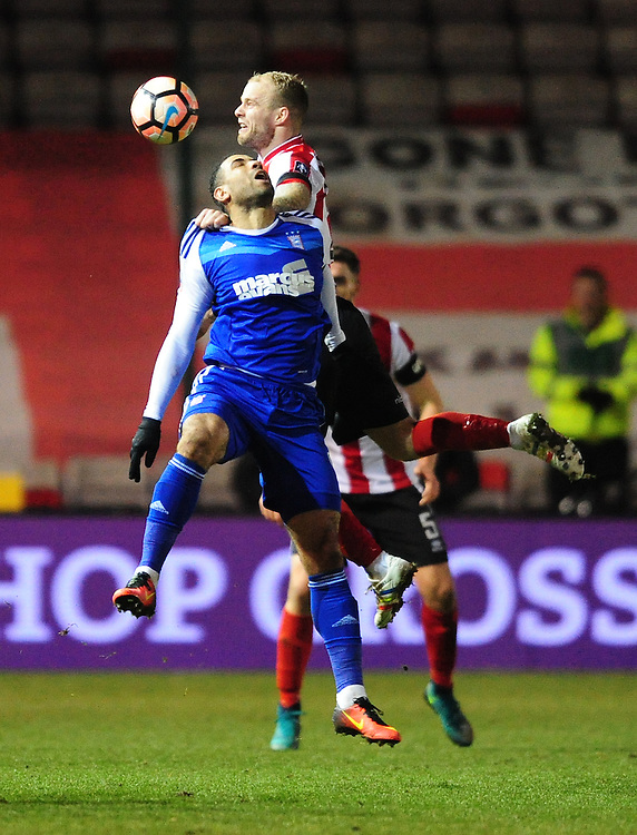Lincoln City's Bradley Wood vies for possession with Ipswich Town's Leon Best<br /> <br /> Photographer Chris Vaughan/CameraSport<br /> <br /> Emirates FA Cup Third Round Replay - Lincoln City v Ipswich Town - Tuesday 17th January 2017 - Sincil Bank - Lincoln<br />  <br /> World Copyright © 2017 CameraSport. All rights reserved. 43 Linden Ave. Countesthorpe. Leicester. England. LE8 5PG - Tel: +44 (0) 116 277 4147 - admin@camerasport.com - www.camerasport.com