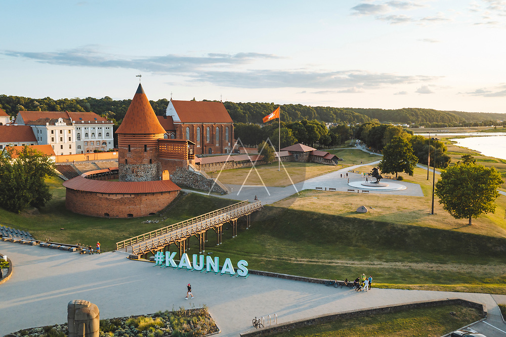 Kaunas, Lithuania - 21 July 2021: Aerial view of Kaunas castle standing in the old town near river Neris.