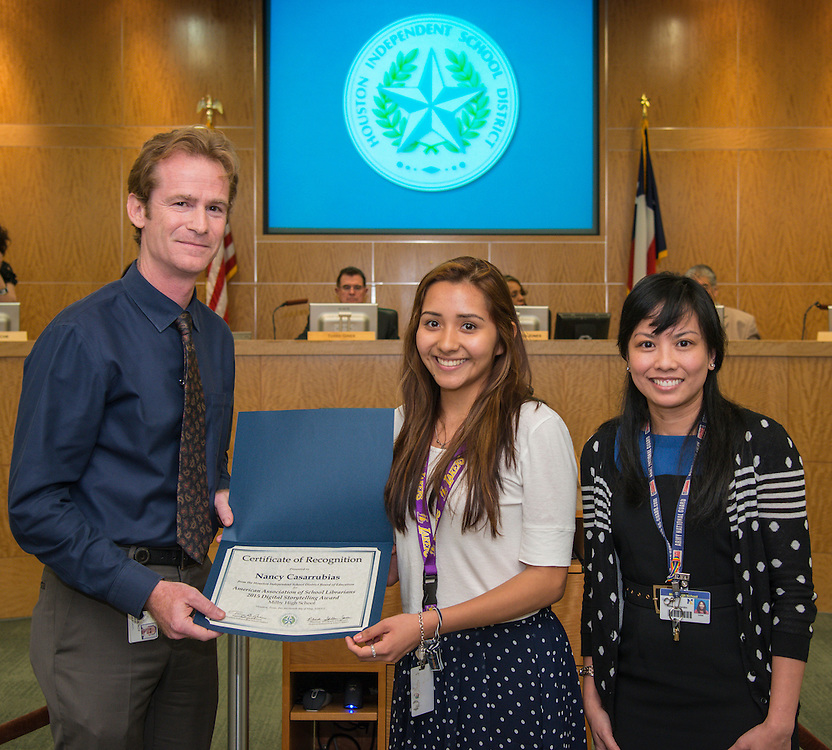 Roy de la Garza recognizes Nancy Casarrubias during the Houston ISD Board of Trustees meeting, May 14, 2015.