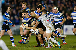 Bath Inside Centre Sam Burgess, making his first start for the Club, loses the ball to Montpellier Inside Centre Wynand Olivier  as replacement Rene Ranger tackles - Photo mandatory by-line: Rogan Thomson/JMP - 07966 386802 - 12/12/2014 - SPORT - RUGBY UNION - Bath, England - The Recreation Ground - Bath Rugby v Montpellier Herault Rugby - European Rugby Champions Cup Pool 4.