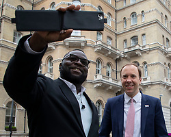 © Licensed to London News Pictures. 11/05/2021. London, UK. Secretary of State for Health and Social Care Matt Hancock takes a selfie with a member of the public ahead of speaking to the media outside the BBC. Photo credit: George Cracknell Wright/LNP