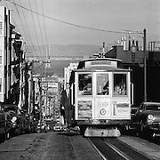 San Francisco Cable Car at the top of a hill in San Francisco
