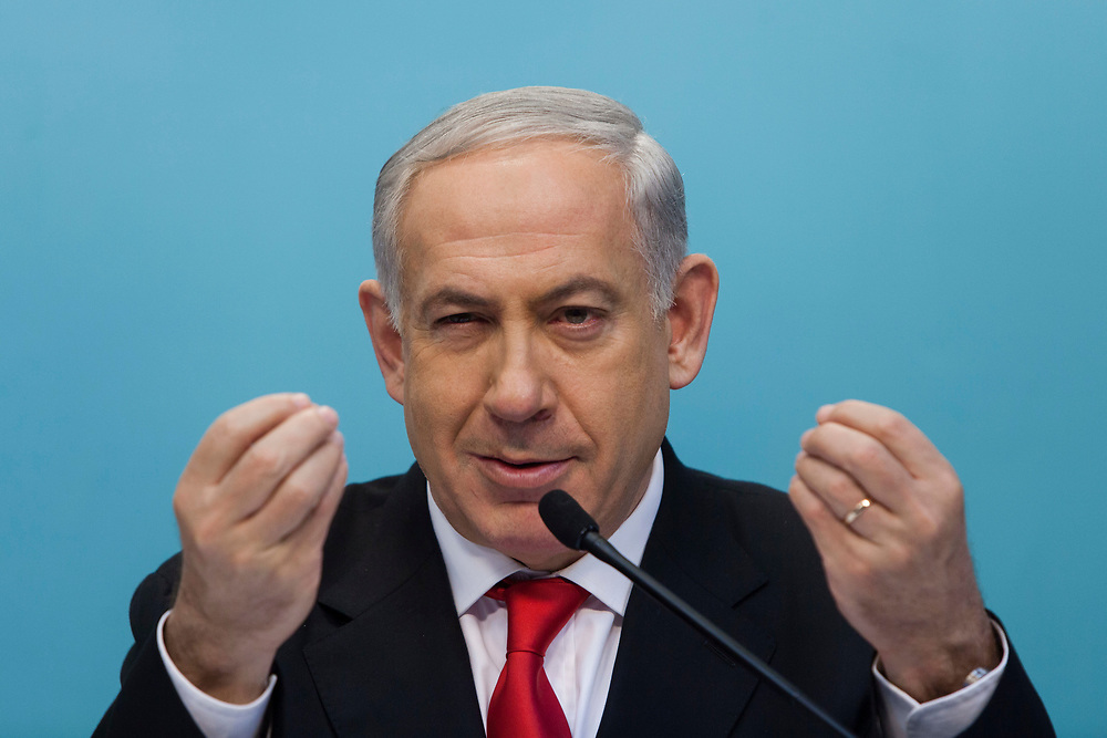 Israel's Prime Minister Benjamin Netanyahu gestures as he speaks during a press conference in which the Israeli government presented a new planned sea ports reform in Israel, at the Prime Minister's Office in Jerusalem, on July 3, 2013. The Israeli government initiated a tender for two new private ports to operate beside existing government-owned ports in Haifa and Ashdod in a bid to raise competition, break the monopoly in the current system and lower the costs of good in Israel.