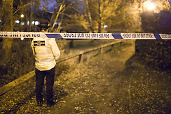 © Licensed to London News Pictures . 02/12/2013 . Bramhall , Stockport , UK . Police and forensic scenes of crime investigators work at the scene where the dead body of a teenaged boy was pulled from a pond off Brent Moor Road , today (2nd December 2013) . Photo credit : Joel Goodman/LNP