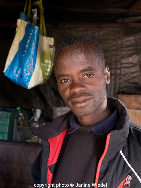 Young Ethiopian man in his makeshift home in the Calais Jungle Refugee and Migrant Camp in France