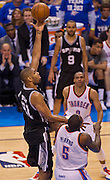 June 2, 2012; Oklahoma City, OK, USA; San Antonio Spurs forward Tim Duncan (21) drives toward the basket past Oklahoma City Thunder  center Kendrick Perkins (5) during a playoff game  at Chesapeake Energy Arena.  Thunder defeated the Spurs 109-103 Mandatory Credit: Beth Hall-US PRESSWIRE