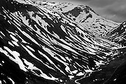 """Furka Pass, with an elevation of 2,429 metres (7,969 ft), is a high mountain pass in the Swiss Alps connecting Gletsch, Valais with Realp, Uri.<br /> The Furkapass (German) Furka Pass showing the route of the retreating Rhone Glacier. The Furka Pass was used as a location in the James Bond film Goldfinger.<br /> The Rhône Glacier (German: Rhonegletscher/ Valais German: """"Rottengletscher"""") is a glacier in the Swiss Alps and the source of the river Rhône and one of the primary contributors to Lake Geneva in the far eastern end of the Swiss canton of Valais.<br /> The Rhône Glacier is the largest glacier in the Urner Alps. It lies on the south side of the range at the source of the Rhône. The Undri Triftlimi (3,081 m) connects it to the Trift Glacier. The glacier is located on the northernmost part of the canton of Valais, between the Grimsel Pass and the Furka Pass and is part of the Oberwald municipality. The Dammastock (3,630 m) is the highest summit above the glacier."""