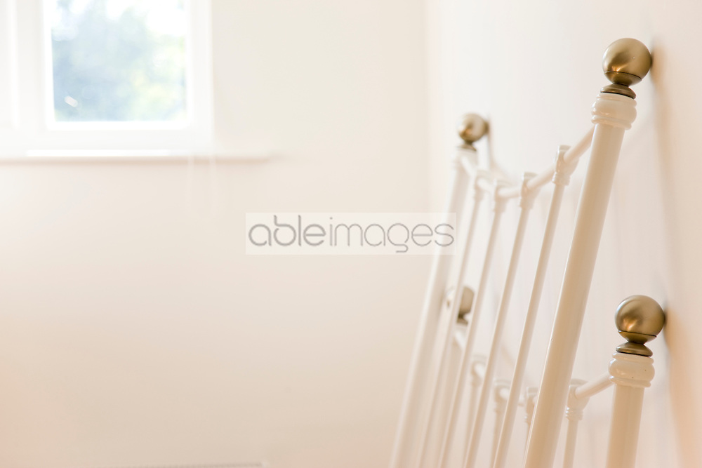 Close up of a disassembled bedstead leaning against a wall